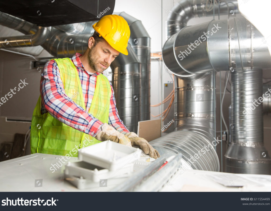 stock-photo-worker-making-final-touches-to-hvac-system-hvac-system-stands-for-heating-ventilation-and-air-611554499